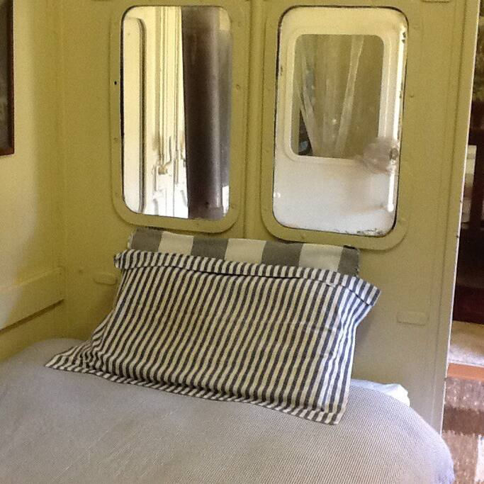 Two single beds in adjacent room