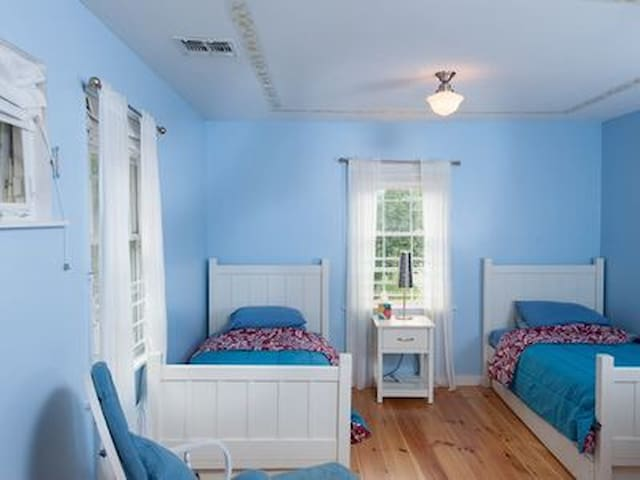 Kids room, 2 twin beds, rocking chair, crib,  and 2 trundle bed. Please let us know if you have extra guests.