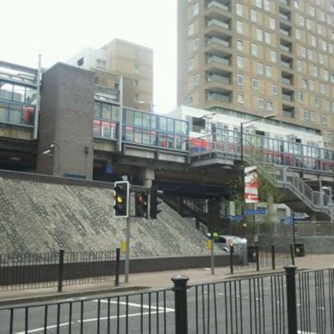 The apartment (peach building in the background) is located right next to Crossharbour DLR station which is extremely convenient - you could not be any closer to a London DLR/tube station