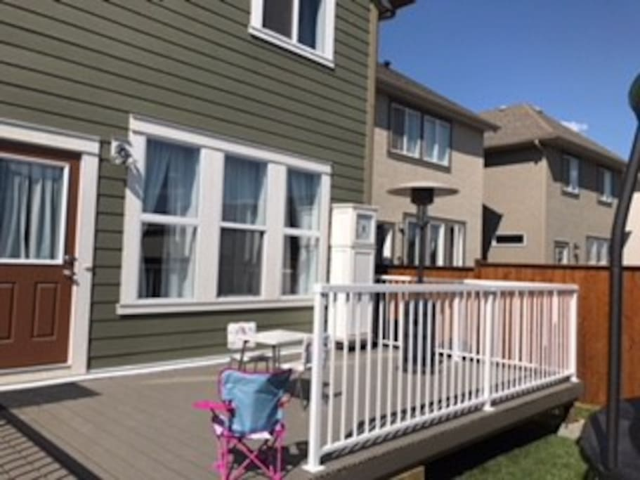 Large deck with heater and BBQ, trampoline for kids and cute little garden