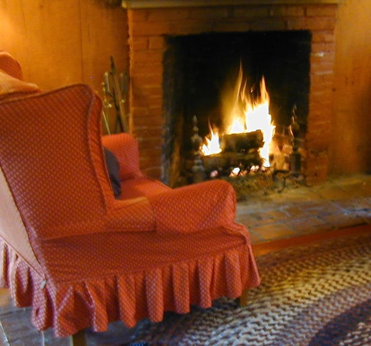 What could be better than a wing chair by a real wood fire?