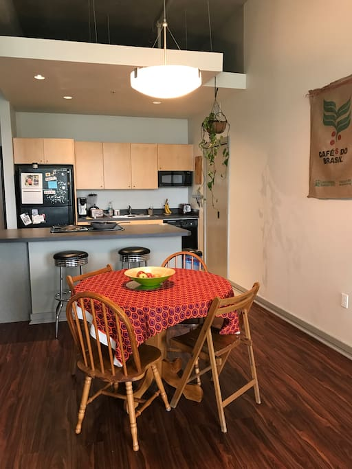 Welcoming open space island kitchen and dining area.