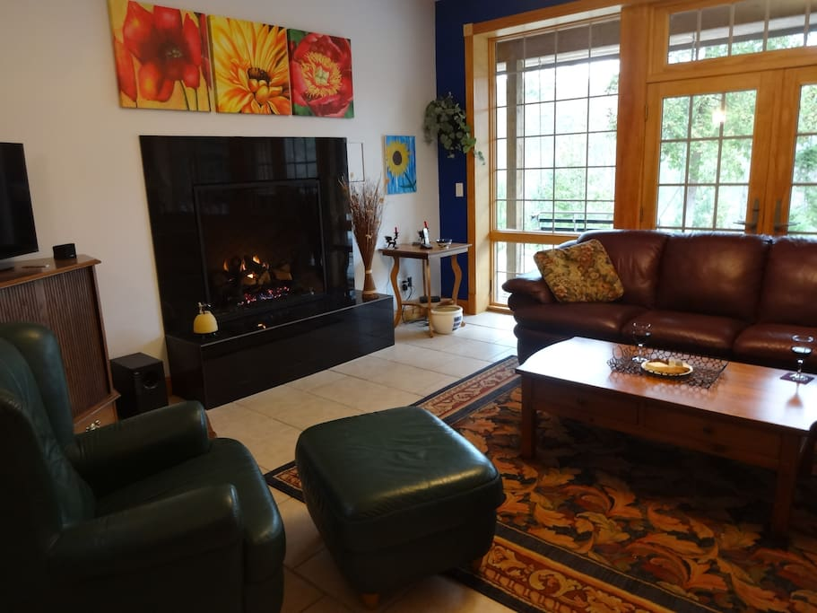 Living room with fireplace, nice views.