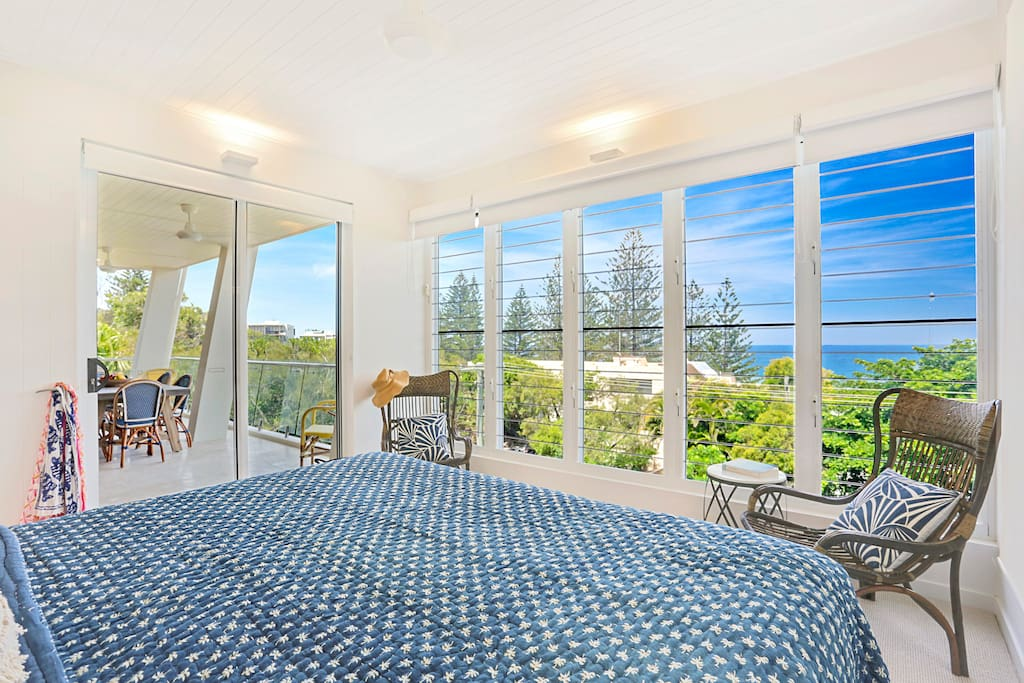 view from master bedroom overlooking ocean and out to terrace