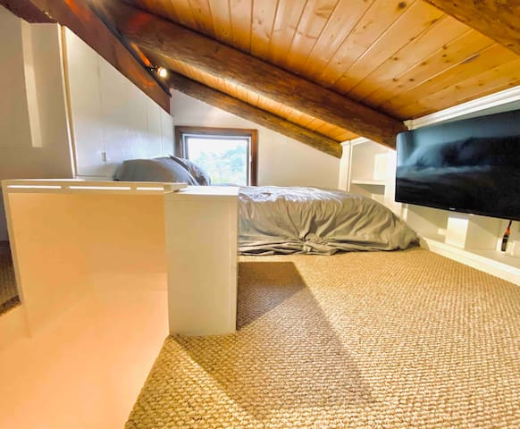 Up secret staircase in kitchen you will find the loft bedroom, with full size mattress and tv.