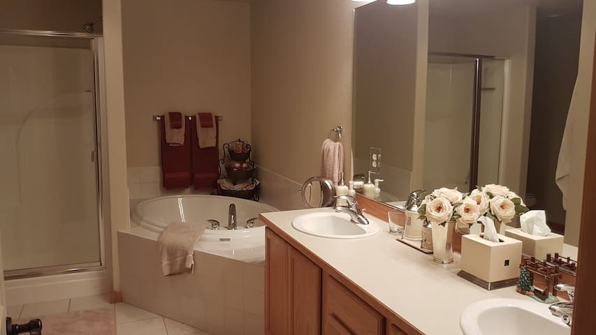 Off the master bedroom is the master bathroom.  2 sink vanity, tub, shower & private toilet. Quality towels, conditioners, body wash and shampoos are there for your use.