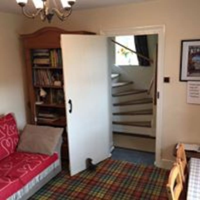Sitting room, showing stairs. Downstairs WC to the right of staircase.