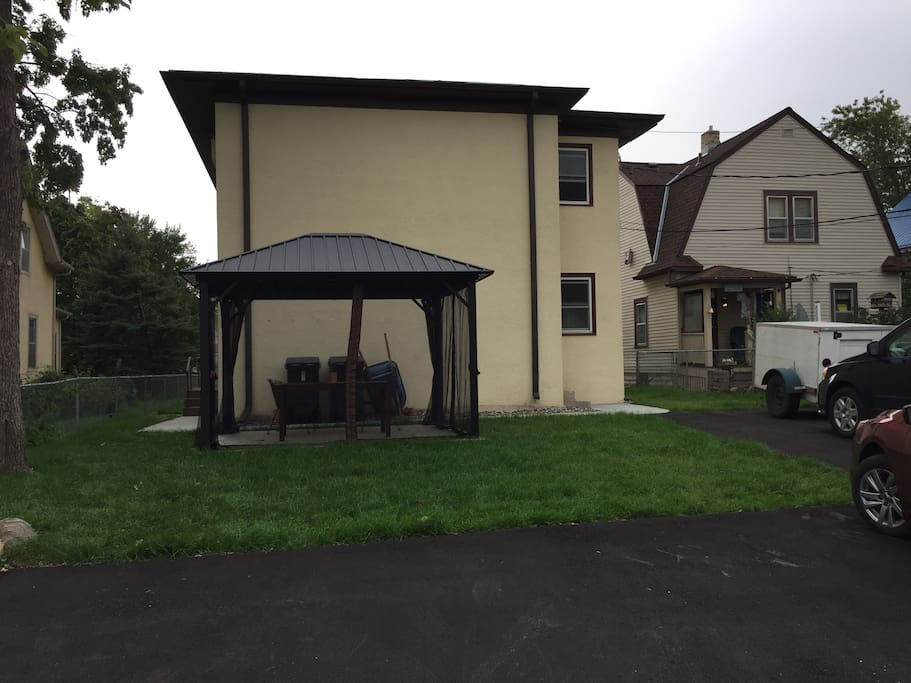 Rear view with parking lot and gazebo.