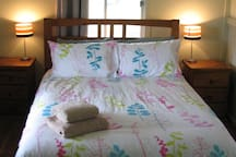 Bedroom 2 is fitted with a cozy double bed, suitable for another couple or a couple of kids.