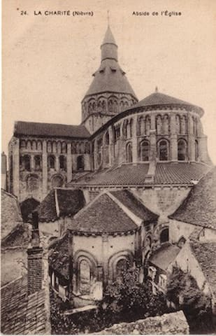 Old photo postcard of the back of the church taken in the early 1900s.