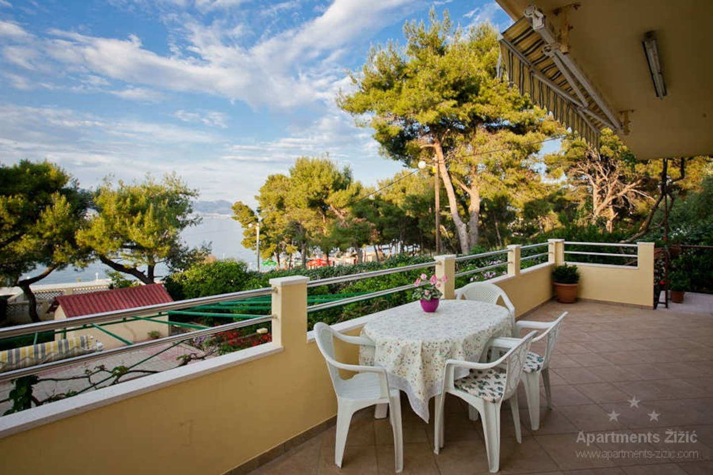 Terrace in front of the apartment with beautiful view on sea and beach.