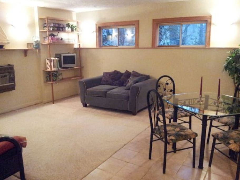 Playroom w/ dining area. (Private bedroom is to the left, behind kids futon sofa, corner shows.)