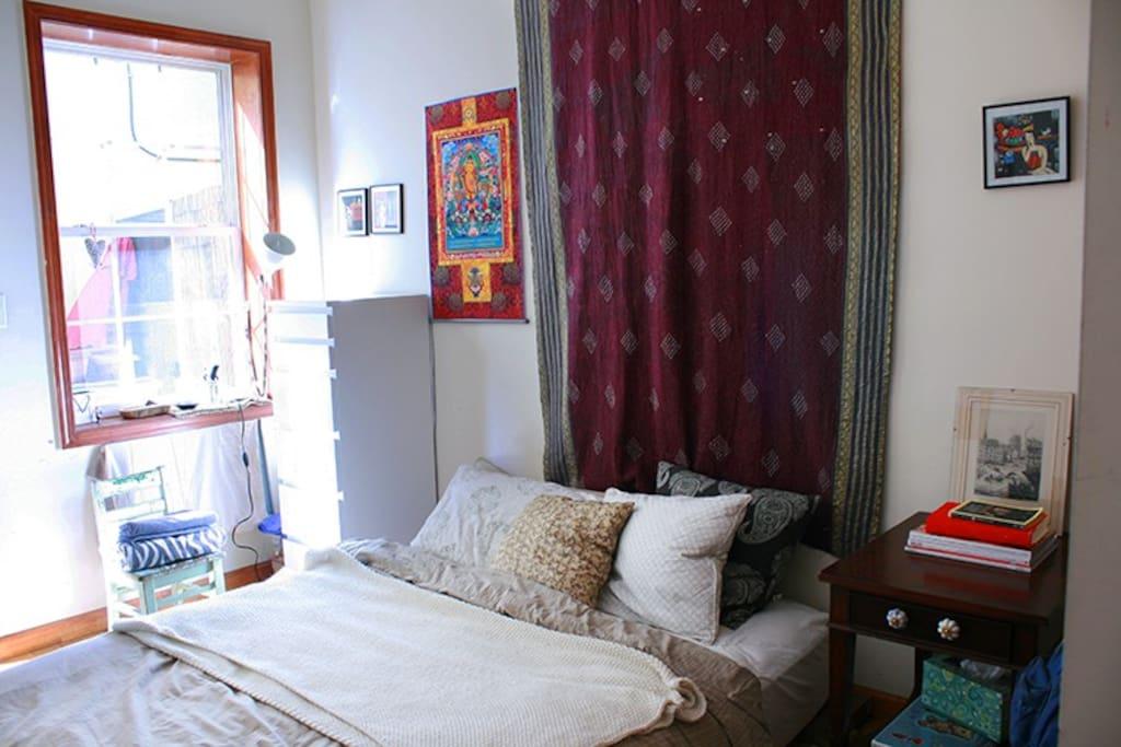 Bedroom door opens to private outdoor space! Open the door and get some fresh sunlight in the morning. :)
