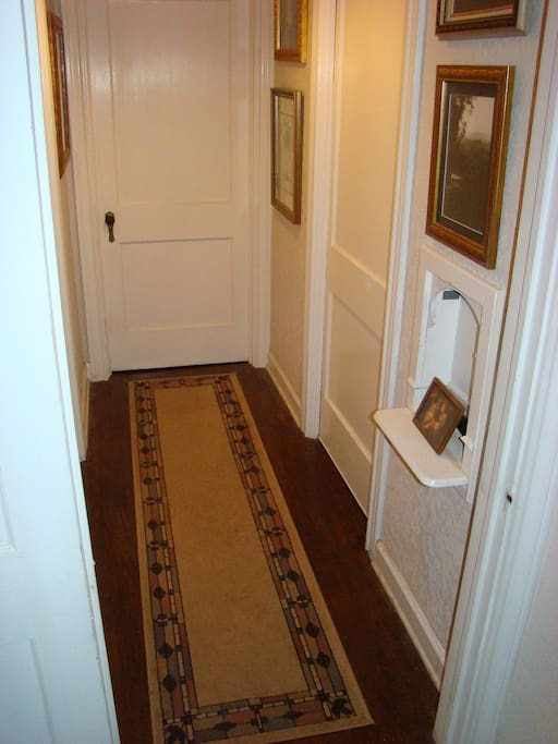 """Hall connects bedroom and bath, private by sliding """"pocket door"""""""