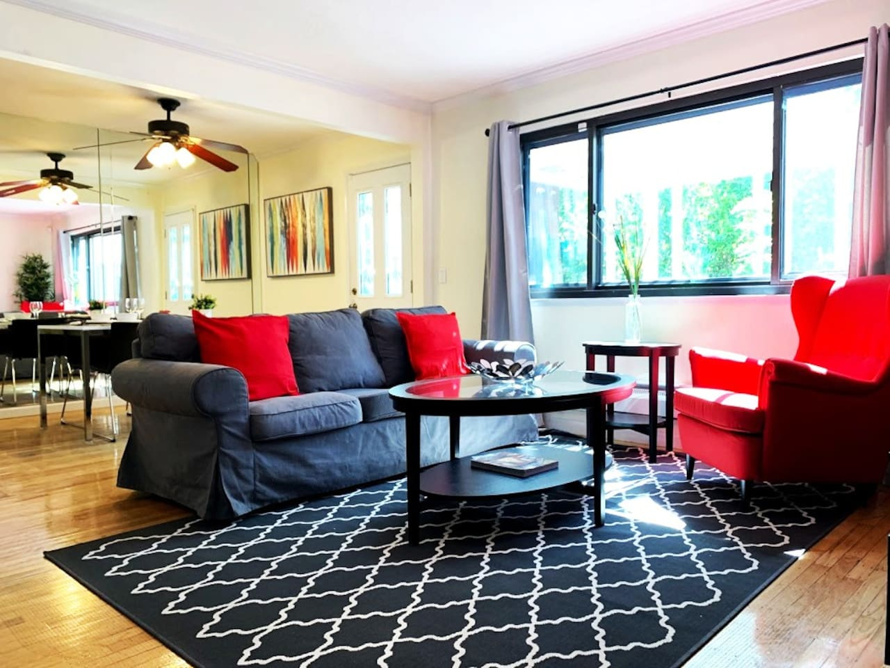 Welcome Guests! Our home has been decorated and furnished with your needs in mind to ensure you have the best possible stay. Sit back and enjoy the contemporary living room that includes a large sofa, wing chair, separate work area and large cable TV