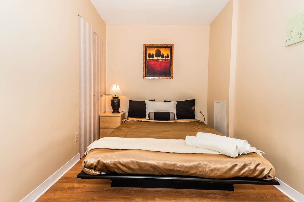 Bed room area with a queen size memory foam bed