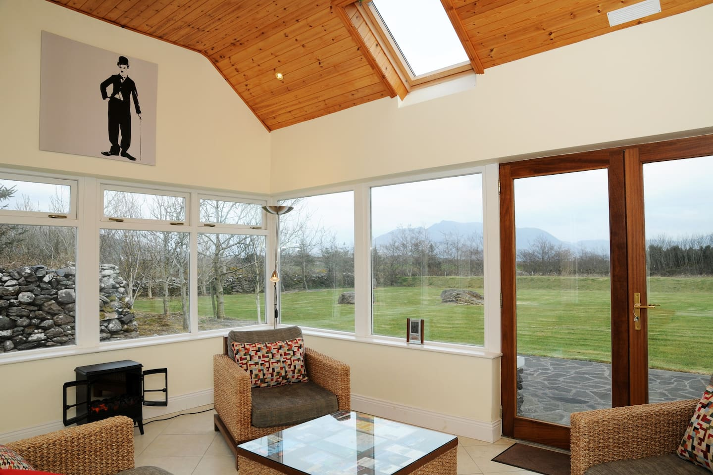 Sunroom off the kitchen overlooking the gardens and Kerry Mountains