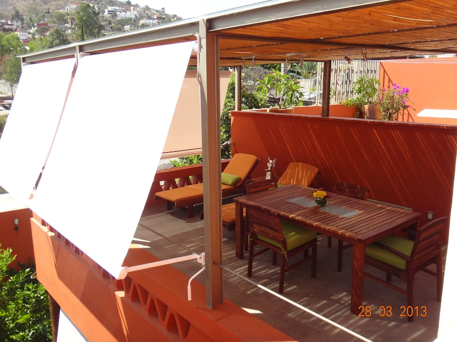 Covered terrace with sun blinds.