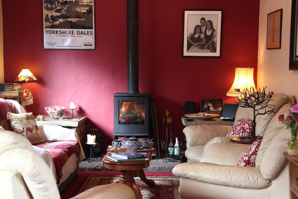 Log burning stove in the spacious lounge with honesty bar, TV, DVD and music.