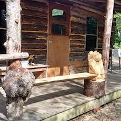 The built in Bear bench was carved by a local artist