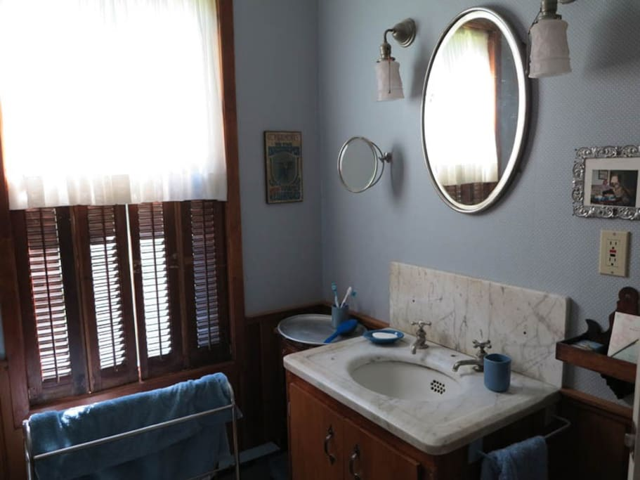 Main bathroom with antique fixtures.