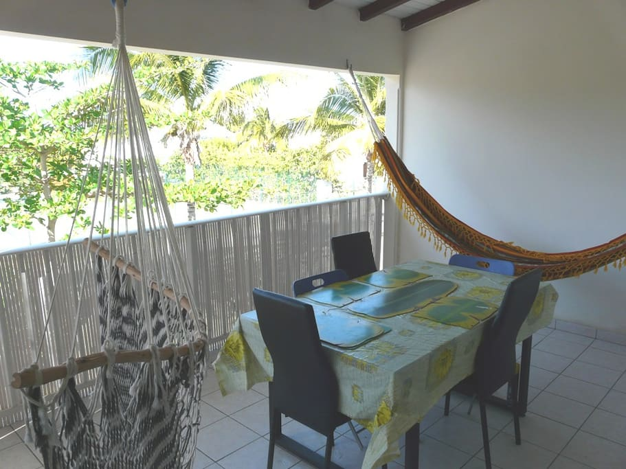 veranda with two hammocks and the dining table