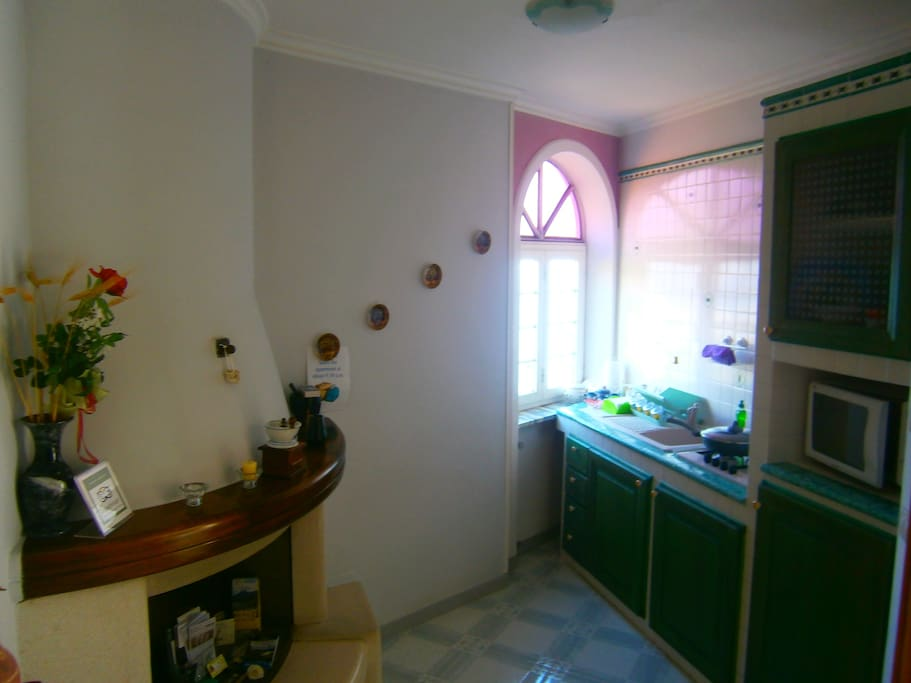 Fully equipped kitchen with microwave oven, fridge and  washing machine