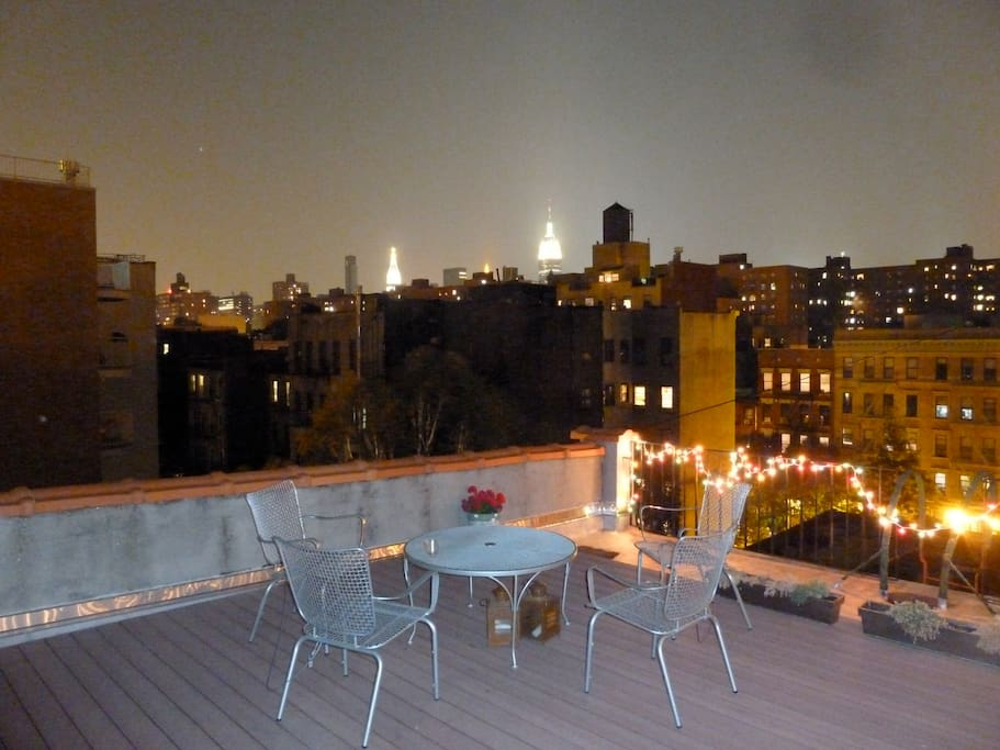 Private rooftop deck. Empire State Building in the distance.
