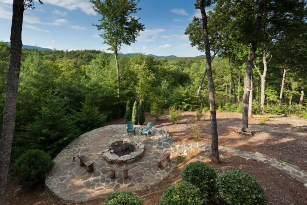 Spectacular mountain top view overlooking the outdoor fireplace