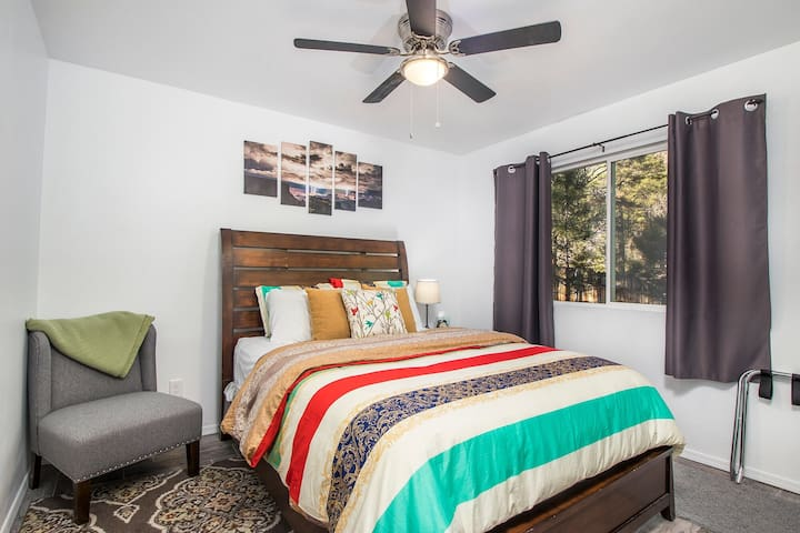 The queen bedroom is bright and cheerful with plenty of space to enjoy the view