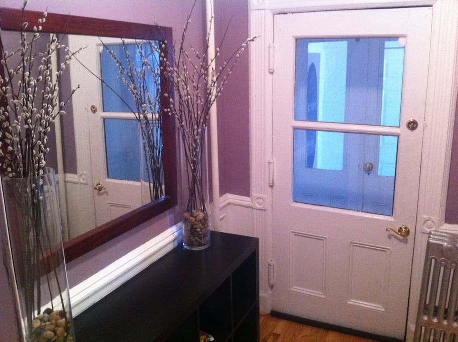the entry way offers storage space and a mirror for a quick look befor heading out.