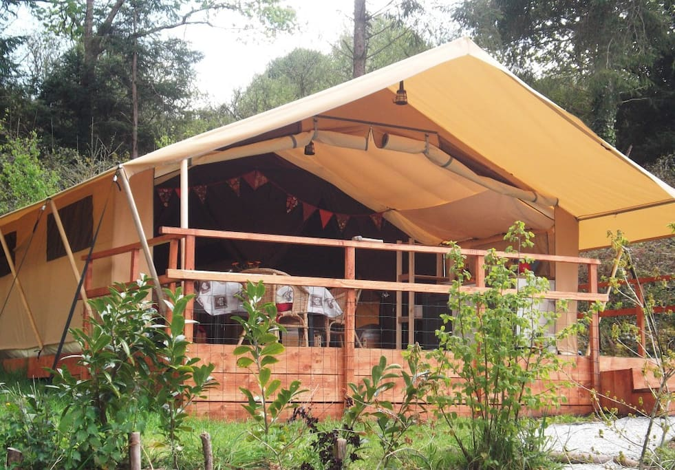 The tent lodge with the front fully open
