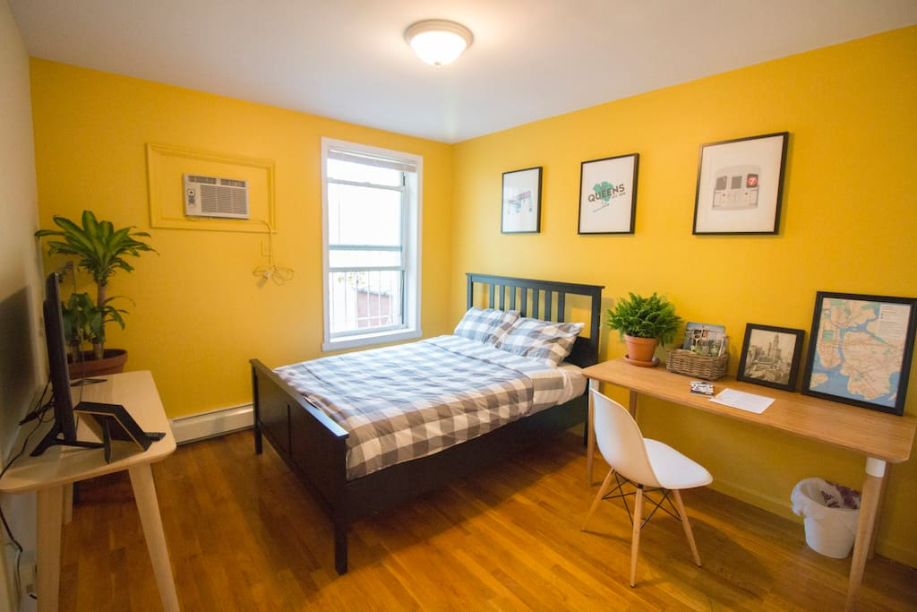 Light and airy bedroom with unique NYC decor. TV with Chromecast, Personal AC, large desk, and huge closet.