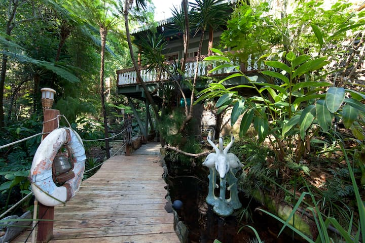 This deck leads past the main house & up to the guesthouse - Photo by Ari Abramczyk