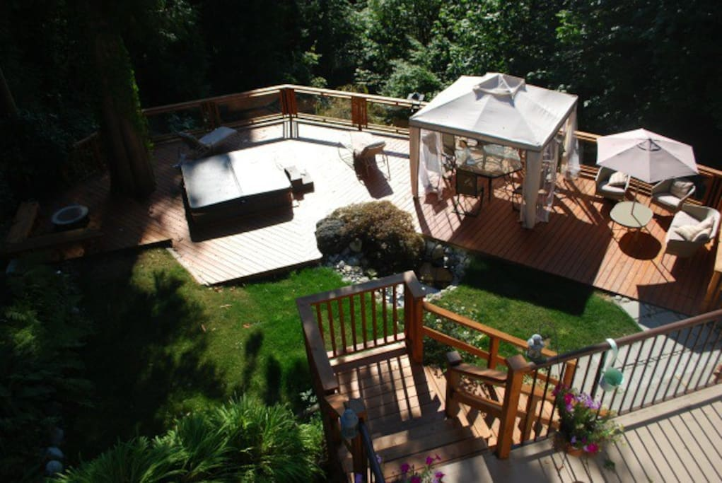 900 square foot deck with sunken hot tub. Views over the Fraser River.