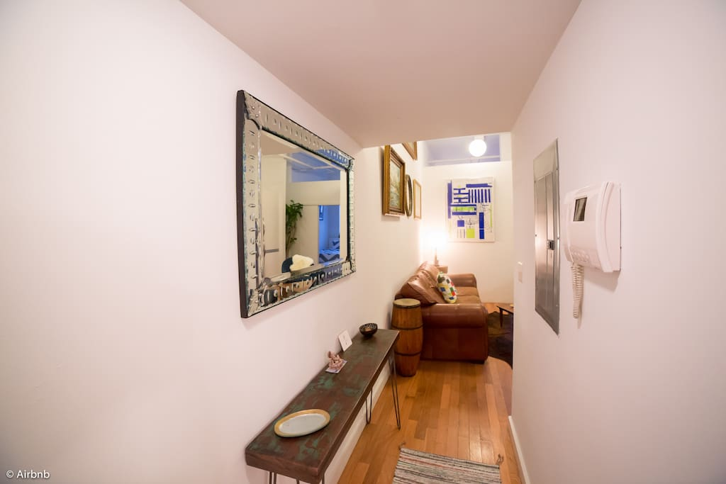 Entryway, bathroom to the right.