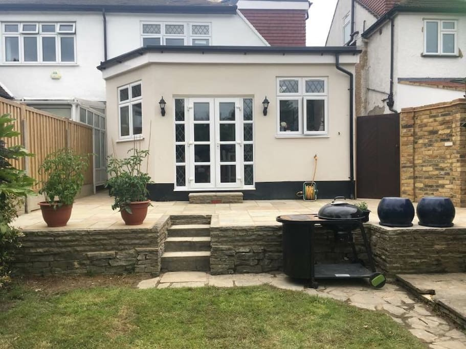 Extension opening onto patio and garden