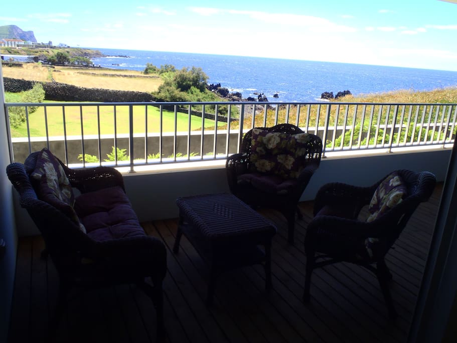 One of the seating areas on the large veranda with a view of the ocean & Mt. Brazil