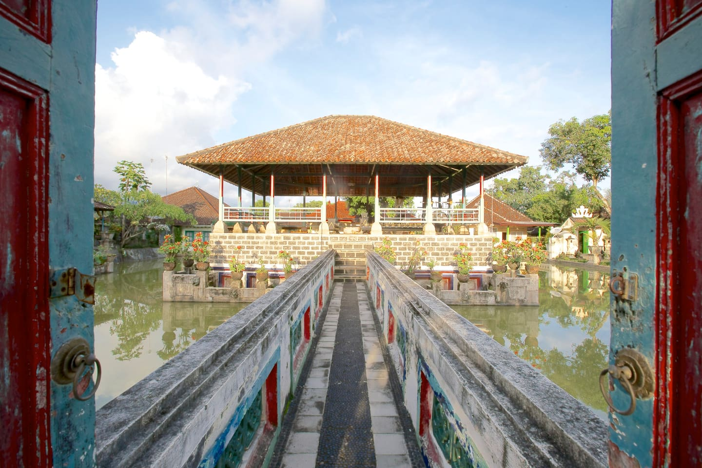 Welcome to Puri Agung Karangasem, this is the main courtyard with the fishpond and chill-out bungalow