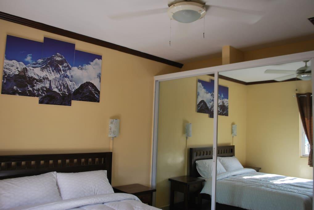 Master Bedroom with Mirror door closet...