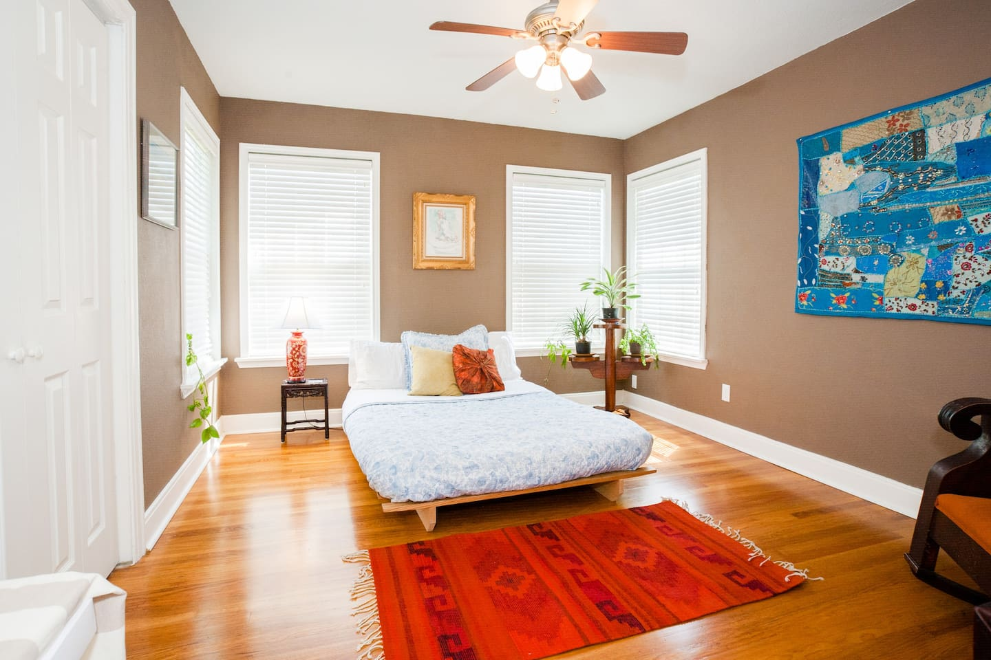 Room #1: sunny, with full sized futon with writing desk,  linen / cotton bedspread, ceiling fan, clean sheets and towels.