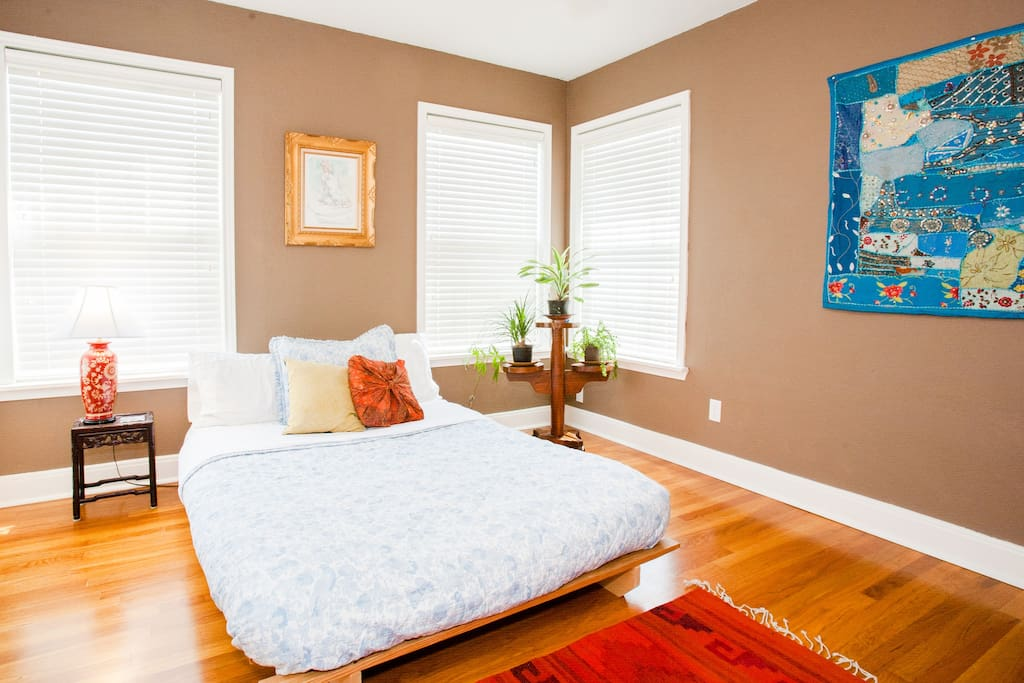 Room #1: sunny, with full sized futon with linen / cotton bedspread, ceiling fan, clean sheets and towels.