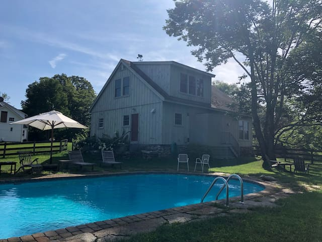 Grey Barn Guesthouse with pool and outdoor shower.