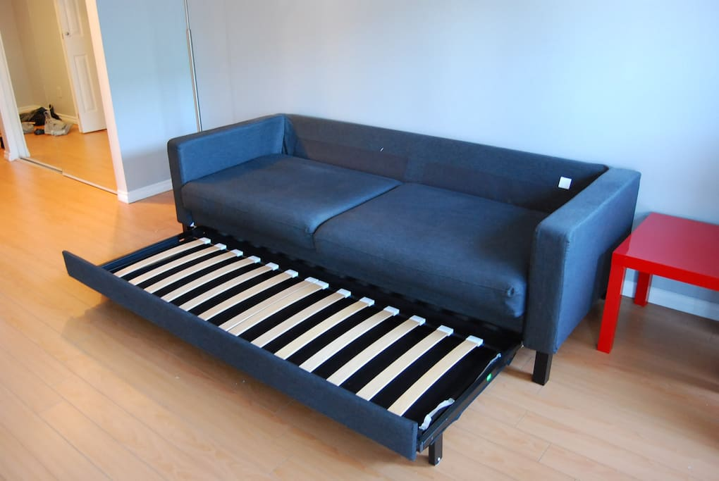 Daybed couch in the process of transforming into a bed
