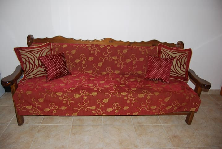 Comfortable bed Sofa in the double room