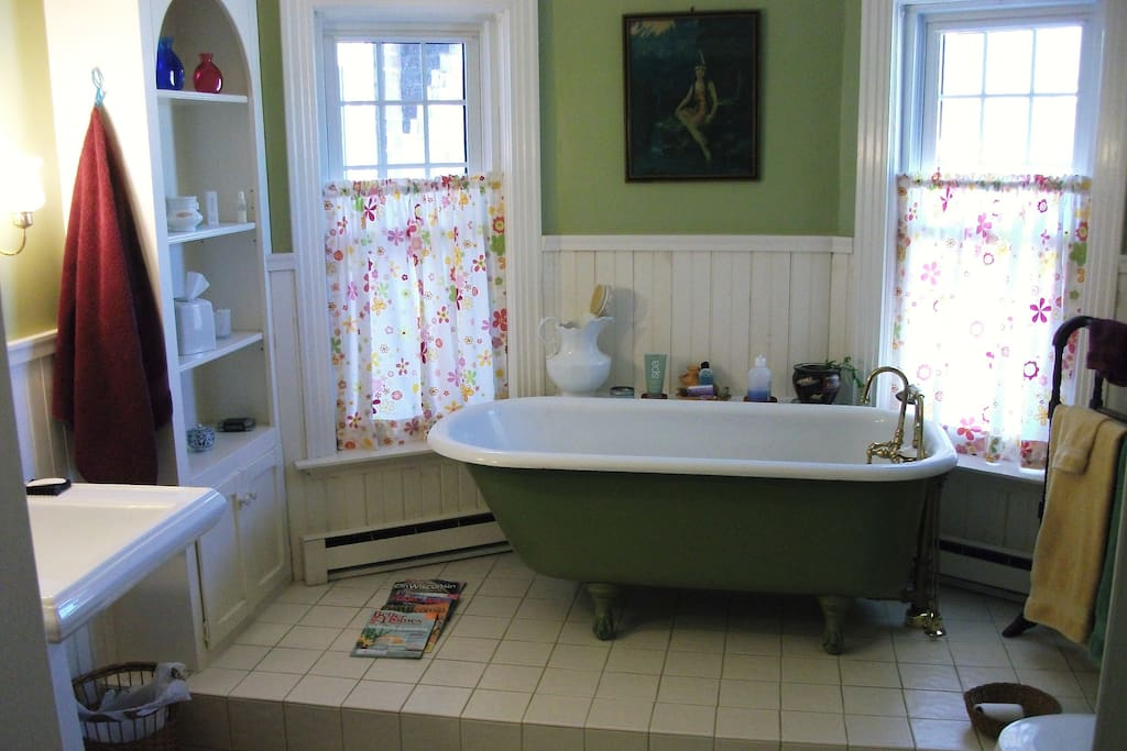 Great bathroom with clawfoot tub and shower stall.