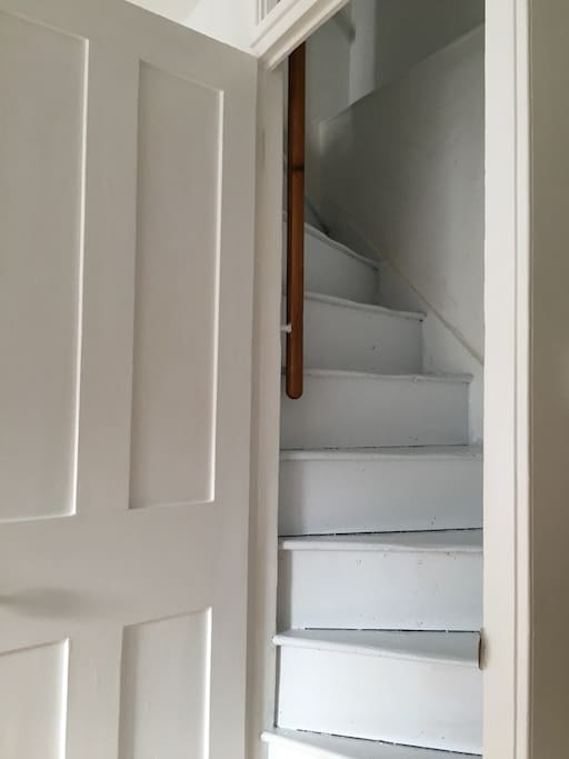 beautiful original stairs with door to close from lounge.