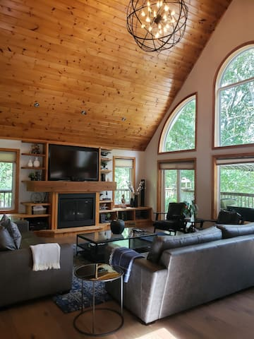 Soaring windows, stunning decor and the perfect view - all create the perfect cottage great room.