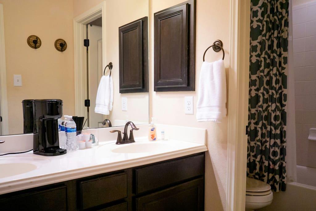 Dual sink vanity. Coffee bar with Organic coffee pods.