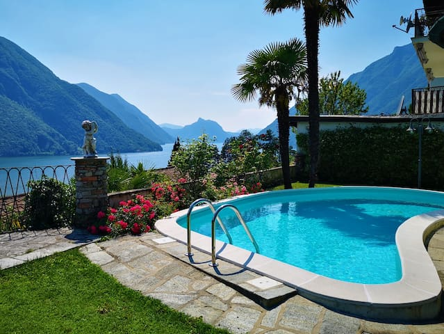 Your villa with heated pool, private beach access and wonderful lake view